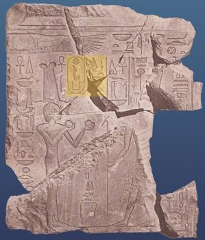 Hatshepsut depicted with a king�s crown and throne name but wearing a dress 